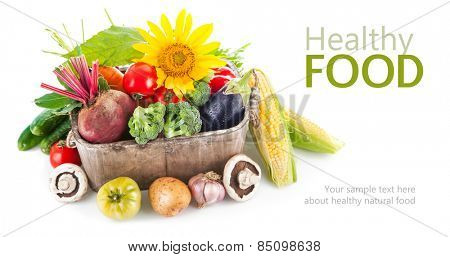 Fresh vegetables in wooden basket. Isolated on white background