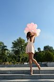 picture of legs air  - Fashion girl with air balloons steps on stairs - JPG