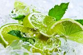 stock photo of peppermint  - lime slices with ice and peppermint leaves - JPG
