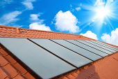 foto of roof-light  - Solar water heating system on the red roof - JPG