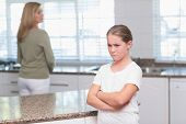 stock photo of argument  - Mother and daughter after an argument at home in the kitchen - JPG