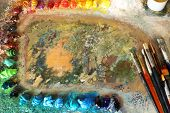 picture of paint palette  - Acrylic paint with brushes on wooden palette - JPG