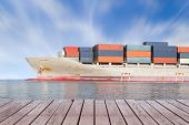 pic of ship  - Cargo ship and cargo container in sea with clear sky background - JPG