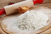 pic of plunger  - Heap of flour on cutting board with egg and plunger on wooden table - JPG