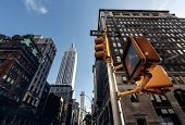 foto of empire state building  - Below view from street on Empire state building in New York - JPG