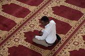stock photo of muslim man  - Black African Muslim Man Is Praying In The Mosque - JPG