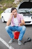 stock photo of breakdown  - Man after a car breakdown at the side of the road - JPG