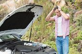 picture of nervous breakdown  - Stressed man looking at engine of his car - JPG