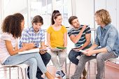 image of homework  - Group of college students doing homework - JPG