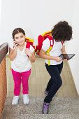 picture of ten years old  - Two ten year old schoolgirl using computer tablet and smart phone - JPG