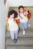 stock photo of identical twin girls  - Ten year old twin sisters go to school - JPG