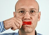 foto of tights  - Man with mouth tightly closed with clamp - JPG