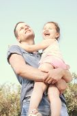 picture of uncle  - Happy little girl on uncle hug - JPG