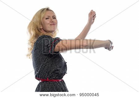 Photo of dancing woman with blond hair
