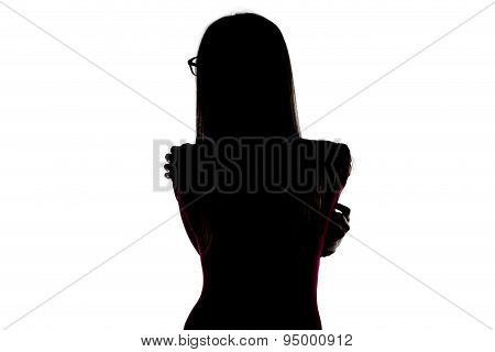 Silhouette of young hugging woman from back