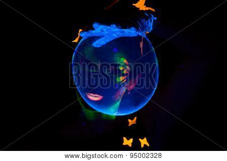 Image of woman looking through luminous bubble