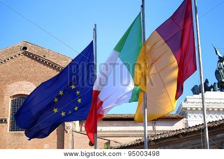 Flags Of Italy, European Union And Roma City Waving In Rome, Italy
