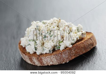rye sandwiche or bruschetta with ricotta cheese and herbs