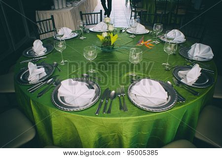 Elegant Table With Silver Clutery And Wineglasses