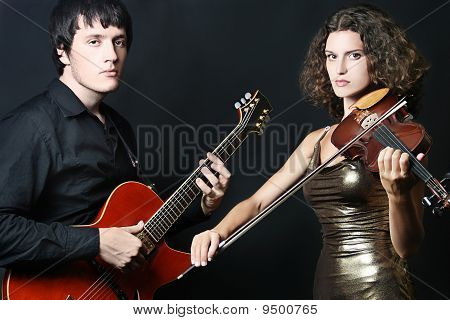 Couple Of Musicians. Guitarist And Violinist