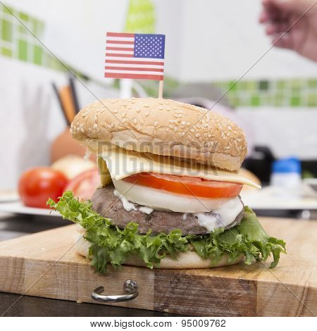 Chef Cooking And Decorated Hamburger With American Flag