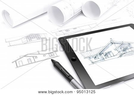 Tablet Computer With Blueprint And Rolls Of Plans