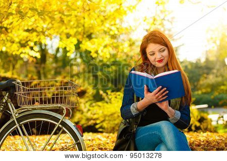Woman Girl Relaxing In Autumnal Park Reading Book