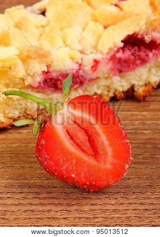 Fresh Baked Yeast Cake With Strawberries On Wooden Table
