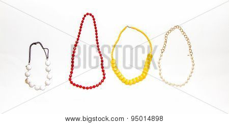 Collection Of Necklaces On White Background.