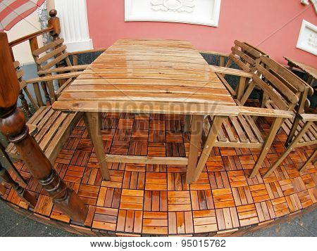 Wet Wooden Table And Chairs After The Rain