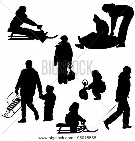 Black Silhouettes Set People And Children With A Sled White Back