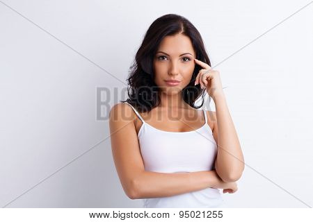 Attractive young woman is assessing and gesturing