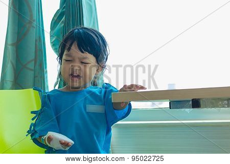 Illness Asian Kids Sit On A Chair In Hospital, Saline Intravenous (iv) On Hand