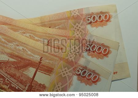 The Russian notes in 5 thousand rubles on a white background