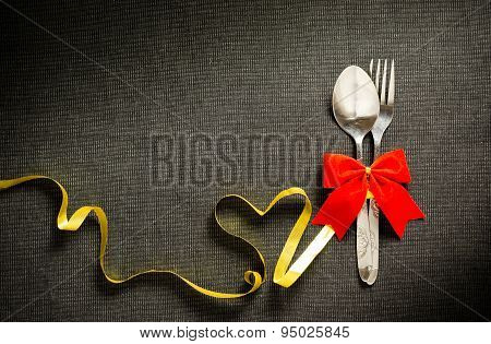 Fork And Spoon With Ribbon And Heart Shape
