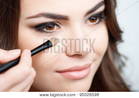 Attractive young woman is preparing for meeting