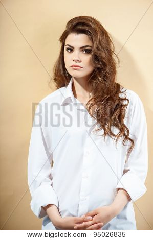 Beautiful young woman in wide white blouse
