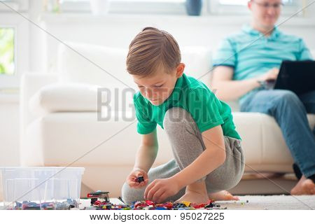 Little Boy Play, Father Works With Laptop