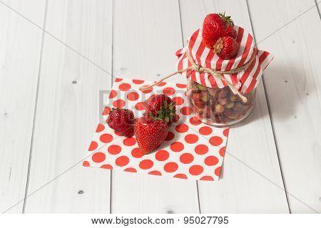 Ripe strawberry in jar