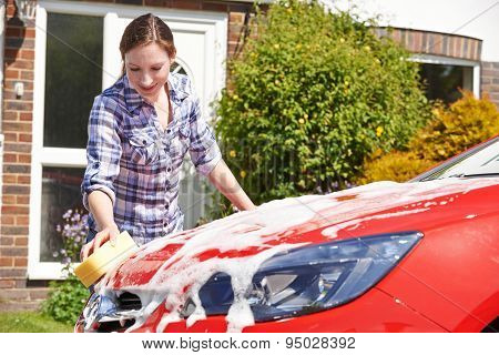 Woman Washing Car Outside House