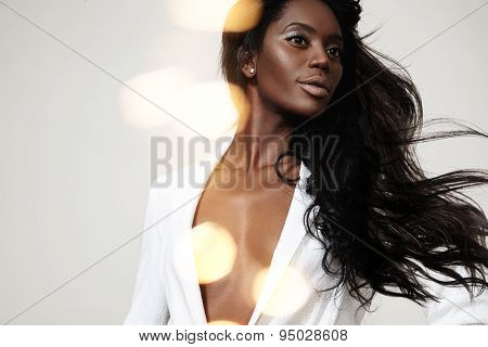 Beauty Black Woman With A Stright Blowing Hair And Bokeh