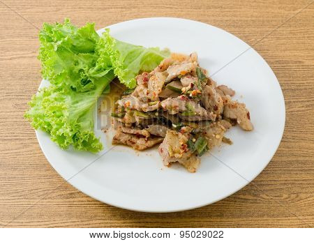 Plate Of Spicy Grilled Beef Salad On Wooden Table