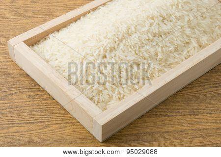 Thai Jasmine Rice In Brown Wooden Tray