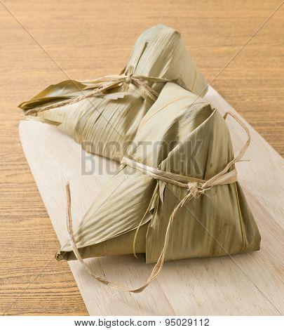Zongzi Or Sticky Rice Dumpling Served On A Wooden Board