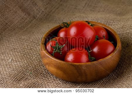 Bowl From Exotic Wood Full Of Tomatoes