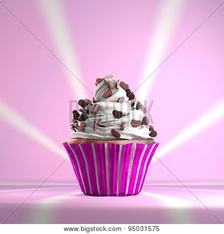 Delicious cupcake with chocolate hearts on a whipped cream.
