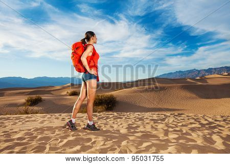 Woman with rucksack standing in Death valley