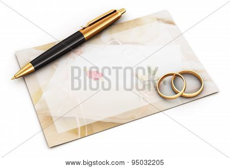 Wedding rings, pen and empty card
