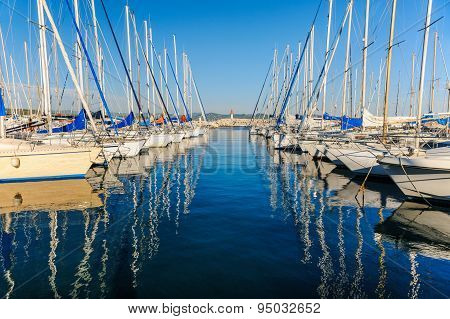 Large yacht harbor in yellow sunset light