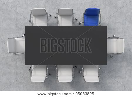 Top View Of A Conference Room. A Black Rectangular Table And Eight Chairs Around, One Of Them Is Blu